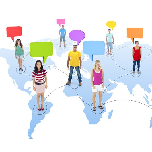 Global Communications graphic with different people standing on a map of the world