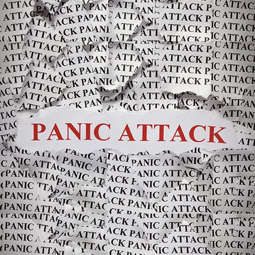 "Torn pieces of paper with the word ""Panic Attack"". Concept Image. Close-up."